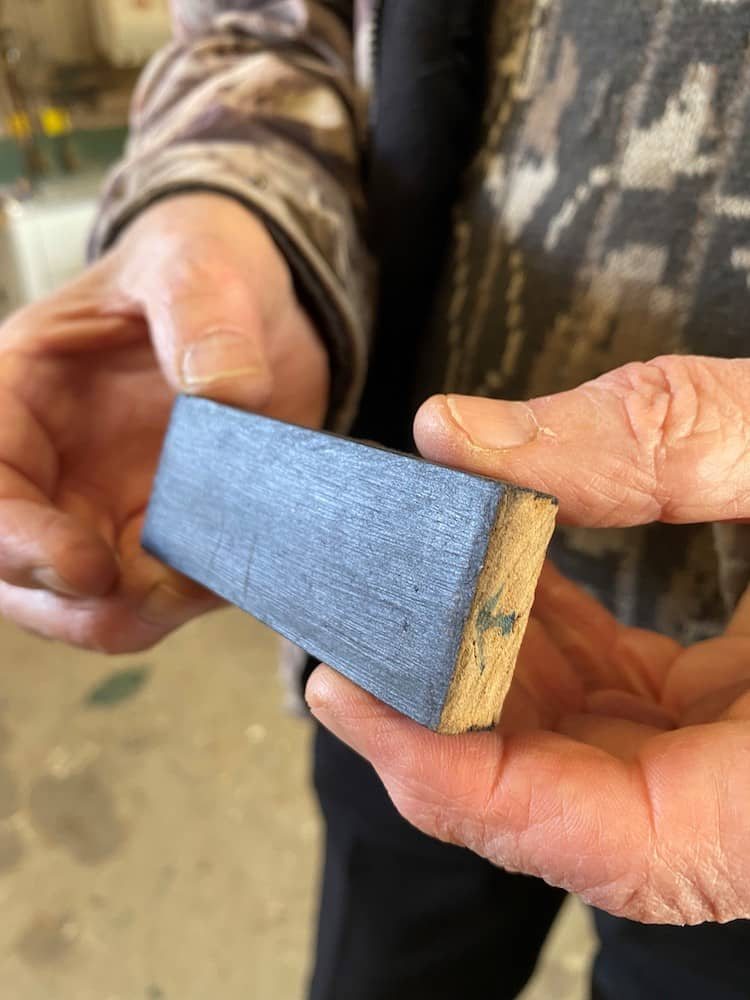 A piece of high-performance engineered timber held in two hands