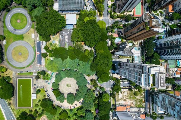 Overhead view of a park surrounded by skyscrapers